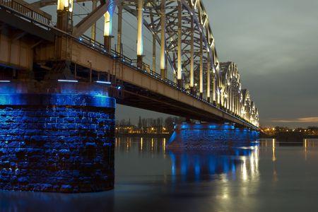 Illuminated Riga Railway bridge over river Daugava at night