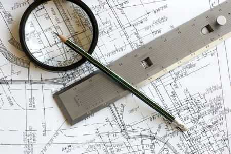 Engineering blueprint with pencil, loupe and steel scale ruler Stock Photo