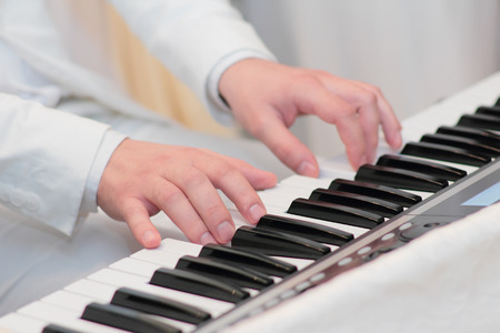 Pianists hands playing on piano photo