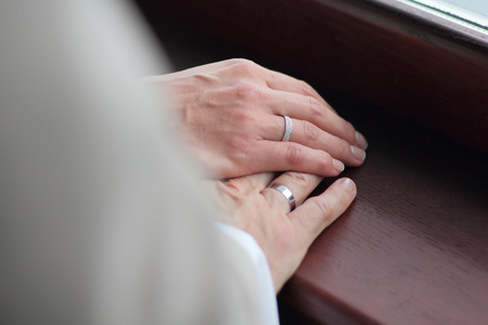 familiy: Two hands with rings of married people Stock Photo