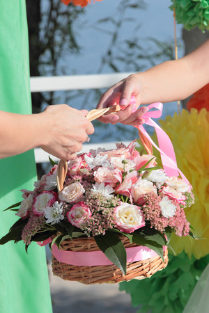 Celebration bouquet in two women hands