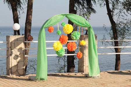 Colorful wedding arch near the water