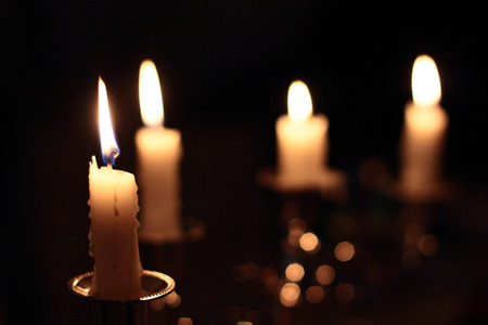 Four candles in the darkness