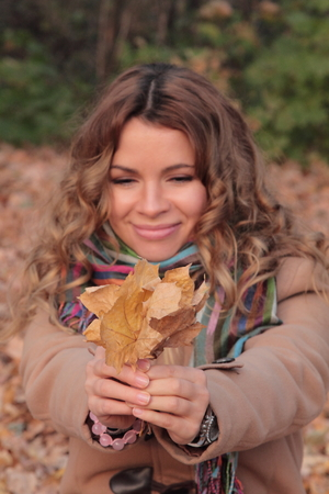 Young, smiling and pretty woman photoset in the autumn park