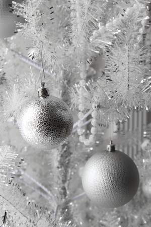 Christmas and new year toys and balls on the artificial tree