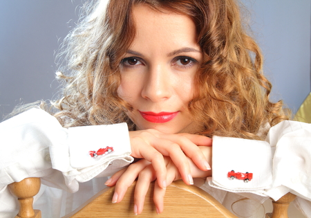 Young woman in white shirt with red racing car cufflinks photoset