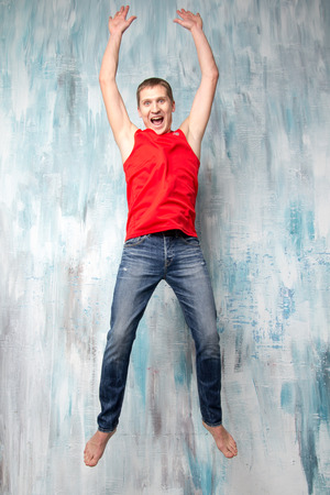 Man jumping near the colorful wall