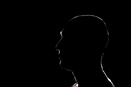 Silhouette of man on the black background