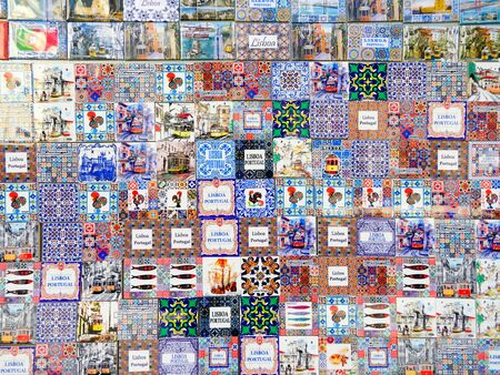 Different ceramic magnet souvenirs for sale at the local store in Portugal, Lisbon Archivio Fotografico - 139872423