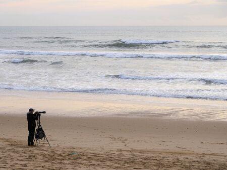 Photographer Enjoying Beautiful sunset on the Beach