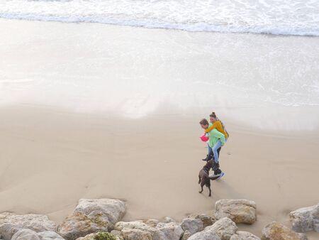 Happy Romantic Couple Enjoying Beautiful Walk on the Beach