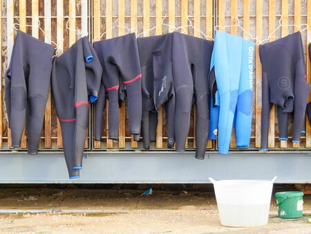 Costumes for Surf drying on the shore rental store Editoriali