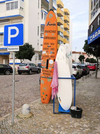 Surf Board on the street near the shop for surfers Editoriali