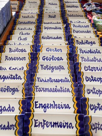 Different ceramic magnet souvenirs for sale at the local store in Portugal, Lisbon Archivio Fotografico - 139872404