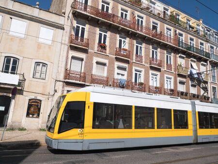 Beautiful Modern yellow tram running on rails Archivio Fotografico - 139872410