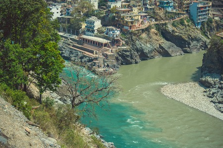 The confluence of two rivers of different colors in the town of Devprayag