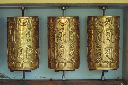 Metal prayer wheels with mantras in Dharamsala.