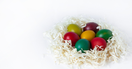 Colored easter eggs isolated on white background, place for text. Stock Photo