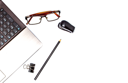 Stationary concept, Flat Lay top view Photo of laptop, pencil, stapled, paper clips, eyepieces, notes on white background with copy space.