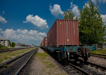 Container loaded on train wagons on a railway.