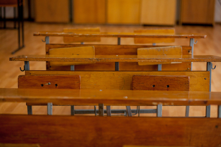 Old Vintage Wooden School Desks in Classroom.