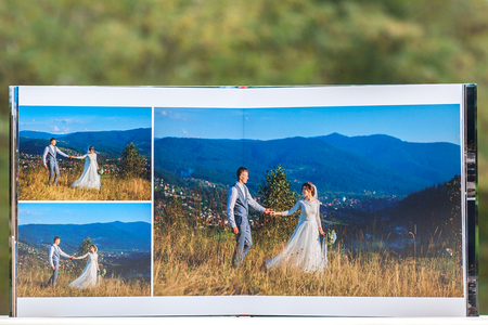 Pages of wedding photobook or wedding album on green background.