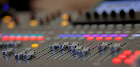 Sound recording studio mixing desk. Music mixer control panel.