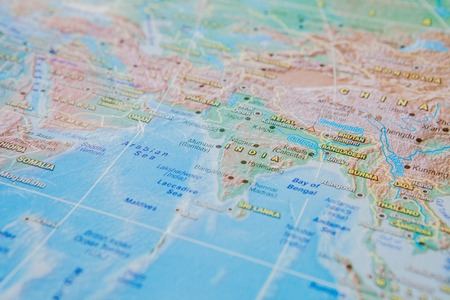 India in close up on the map. Focus on the name of country. Vignetting effect.