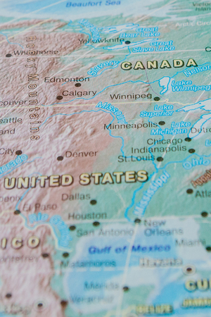 Canada in close up on the map. Focus on the name of country. Vignetting effect. Stock Photo