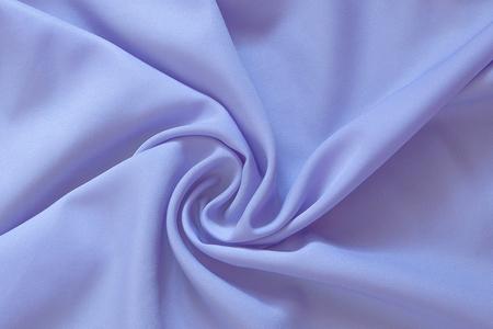 Closeup of rippled purple silk fabric, Beautiful and smooth silk background. Stock Photo