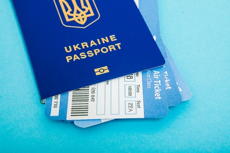 Passport and air tickets on a blue background. mockup empty blank, copy space.