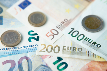 Euro banknotes and coins background . Money and finances concept Banco de Imagens