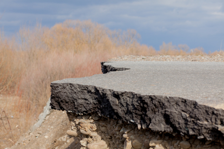 Cross section of asphalt road with blue sky background. 写真素材