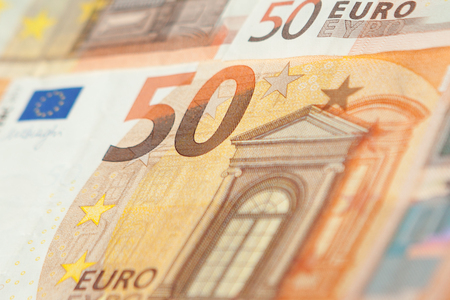 Closeup of a group of fifty euros banknote background.