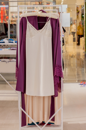 Female red satin nightgown at the store. Advertise, Sale, Fashion concept Banco de Imagens