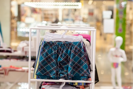 Men's underwear in a boutique. Advertise, Sale and Fashion concept.