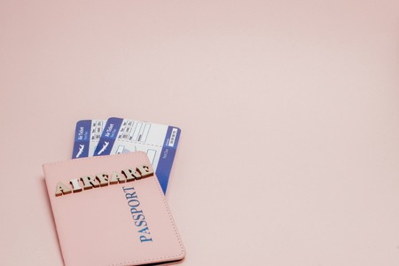 Inscription airfare, Airplane, air ticket and money on a pink background. Travel concept, copy space.