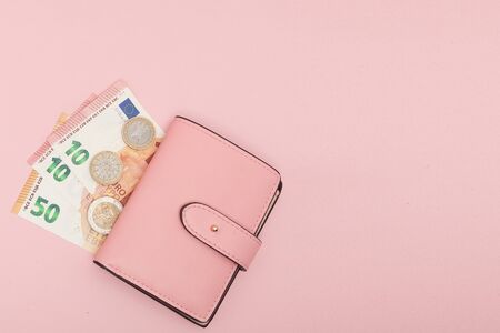 Wallet with Euro Currency on a Vibrant Blue Background. Business Concept and Instagram.