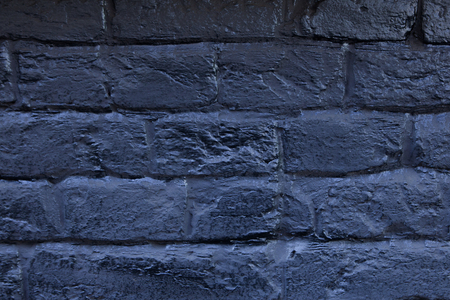 The brick wall painted in blue. Background of old vintage blue brick wall. Blue brick wall .Street light dark blue brick wall. Imagens