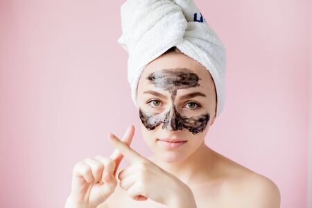 Beauty Cosmetic Peeling. Closeup Beautiful Young Female With Black Peel Off Mask On Skin. Closeup Of Attractive Woman With Cosmetic Skin Care Peeling Product On Face. High Resolution. Banque d'images