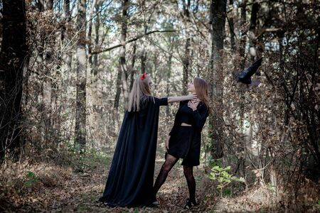 Halloween demon and witch in the woods. 写真素材 - 128854771