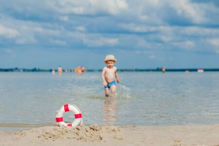 Close-up Of Lifebuoy on the beach on baby background. Safety on the water