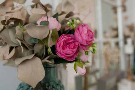 close up of artificial flowers bouquet arrange for decoration in home.