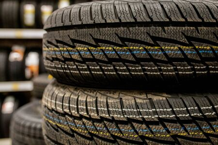 Car tires and wheels at warehouse in tire store Фото со стока