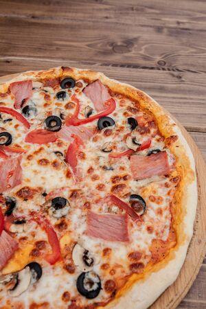 Pizza capricciosa traditional italian meal from prosciutto mushrooms artichokes egg parmesan olives
