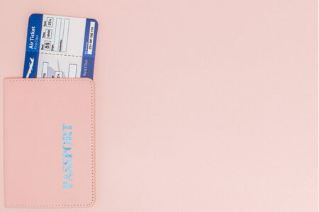 Passport and air ticket on a pink background. Travel concept, copy space. Фото со стока