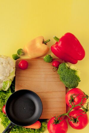 Variety of vegetables and frying pan on a blackboard, top view. Vegan and healthy concept Reklamní fotografie - 132191752