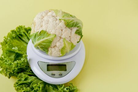 Organic cauliflower on a vase on a yellow background. Healthy eating, diet planning, weight loss, detox, organic farming concept Reklamní fotografie - 132191756