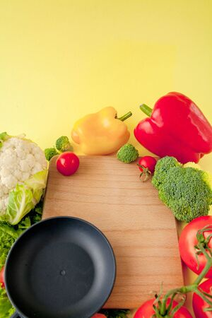 Variety of vegetables and frying pan on a blackboard, top view. Vegan and healthy concept Reklamní fotografie - 132193312