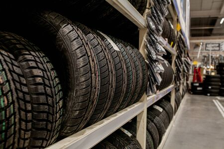 Car tires and wheels at warehouse in tire store 免版税图像